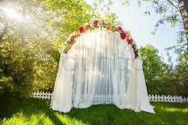 wedding arch wedding arch on the grass stock photo colourbox