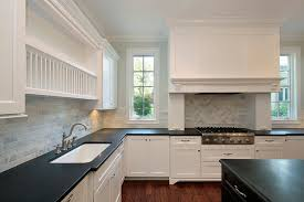 white cabinets with black countertops and backsplash black granite countertops kitchen with white cabinets black