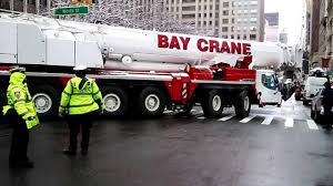 an extremely large bay crane is brought in to help at the crane
