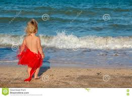 Christmas Baby Girl Playing On The Beach Near The Sea Stock Image