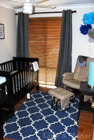 minimalist kids bedroom with kmart navy blue trellis area rug and