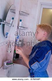 teen boy in the bathroom stock photo royalty free image
