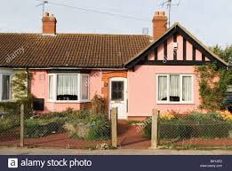 tudor bungalow mock tudor pink semi detached bungalow ipswich suffolk uk stock
