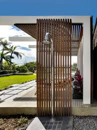 this wood and steel outdoor shower is ideal for rinsing off after