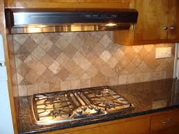 tiles backsplash granite countertops with white appliances fish