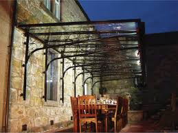 better photo of same site glass verandas enhance any patio or cantilevered glass veranda canopy over dining table setting would be a great addition to my garden or patio space glass verandas seem to be coming more