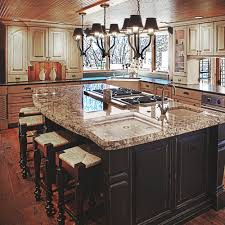 island with stove top and sink black and white distressed