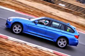 blue station wagon stock mostly f31 328xi station wagon on the track wow