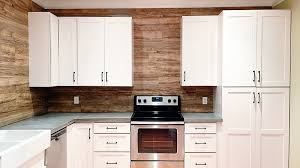 use laminate flooring as a durable easy to clean backsplash in