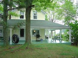 farmhouse with wrap around porch index