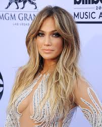 jlo hair color dark hair jennifer lopez s most glamorous hairstyles instyle com