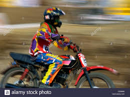 motocross bike race man on bike racing in motocross championship race bombay mumbai