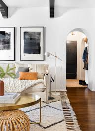 living with less a warm neutral textured boho living room created by brady tolbert