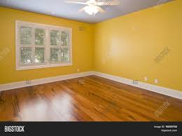 brilliant yellow walls mood with curtains that go 768x1024