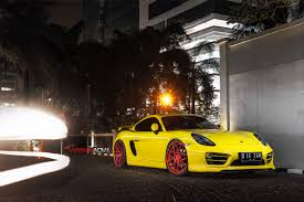 porsche matte red yellow cayman s looking jaunty on matte red custom wheels