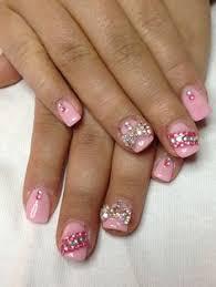 orange nails with diamonds and a cute nail design pretty