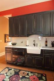distressed black kitchen cabinets with farmhouse sink and antique