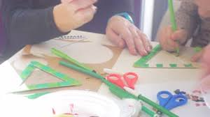 Kids Coloring Table Kids And Educator Are Coloring A Triangle Green Marker Sequins And