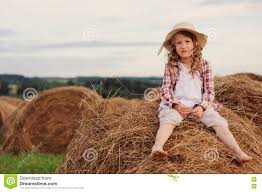 happy 7 years old child in country style plaid shirt and hat
