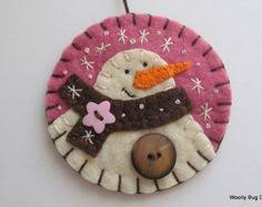 this happy snowman ornament is made of snow white wool felt the