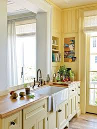 yellow kitchen with butcher block countertops and ceramic white