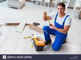 Laying Laminated Flooring Repairman Laying Laminate Flooring At Home Stock Photo Royalty