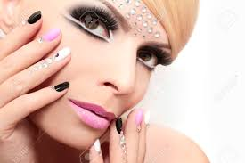 fashion nails and makeup with rhinestones on nails and on the