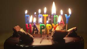 happy birthday candles happy birthday candles on birthday cake with melting wax stock