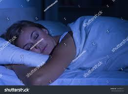 serene woman sleeping night bedroom stock photo 124050577 serene woman sleeping at night in the bedroom