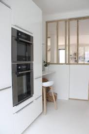 a designer s own scandi style ikea hack galley kitchen in the wall ovens breakfast nook and glass partition wall in designer ilaria fatone s kitchen in