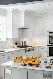white shaker kitchen cabinets with gray quartz countertops boston transitional kitchen grey peninsula design build