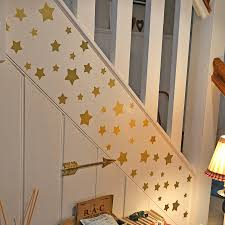 gold wall stickers sticker creations christmas gold stars wall sticker set by oakdene designs