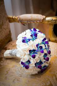 Violet Wedding Flowers - vibrant multicultural wedding white wedding bouquets white