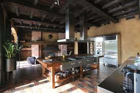 kitchen with exposed joists a large cooking island and a wood