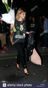 pixie geldof leaving bungalow 8 with flowers and wearing an eminem