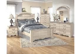 Catalina King Poster Bed Ashley Furniture HomeStore - Ashley furniture bedroom set marble top