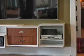modern wood floating media cabinets for bedroom area