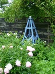 obelisk sundial stately yard ornament trellis or topiary