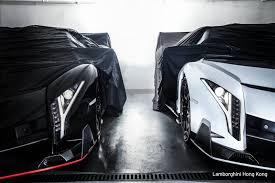 Lamborghini Veneno Black - two lamborghini veneno roadsters pose in hong kong