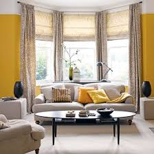 zesty yellow living room with bay window traditional living room