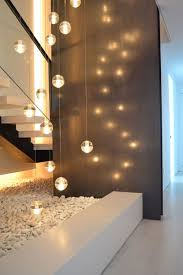 interior lights for home coming up from garage between the two apartments landing before