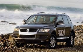 volkswagen touareg black black volkswagen touareg tdi clean diesel on a rocky beach