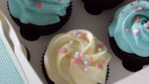 making multicolor cupcakes for kids birthday party stock footage