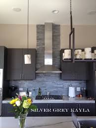 Consider Stacked Stone Ledger Panels For A Textural Wall Look - Stacked stone veneer backsplash