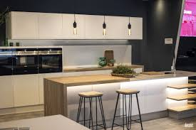 white kitchen cabinets with black island smart breakfast bar black island with solid surface countertop