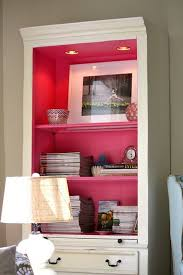 pop of color paint the inside shelves and back of a bookcase a