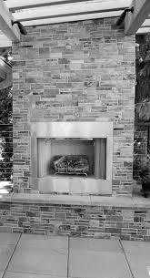 portfolio brick patio and outdoor stone fireplace paver with a