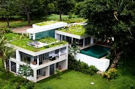modern green home zero energy design amazing design home with garden on the roof and swimming pool with bed chair for tanning and have white style paint