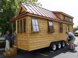 appealing portable log cabins on wheels with knotty pine wood wall