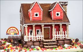 gingerbread cookie house with a lawn